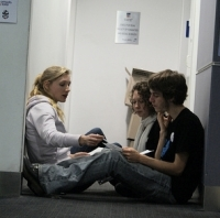 A picture from AYCC Power Shift 2010 Adelaide. I'm with two other climate activists, planning a speech on climate change.