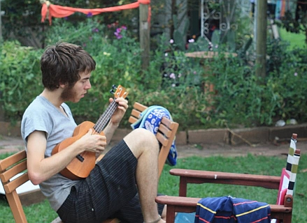 I am playing ukulele in my family garden in Adelaide.
