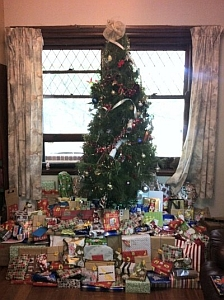 a christmas true laden with gifts, an example of receiving gifts as a love language