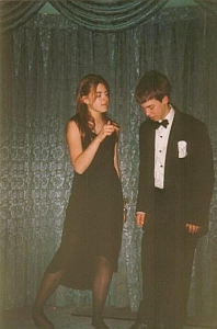 A picture of me with my girlfriend in year 8. we both look quite young. We are dressed formally.