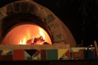 a pizza oven with embers burning