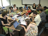 a crowded room of people at laptops