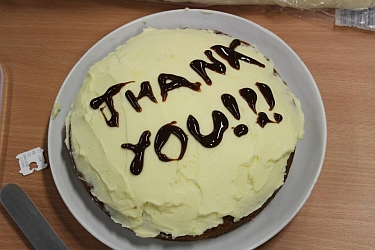 "a picture of a cake saying ""thank you"""
