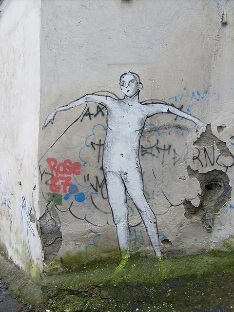 street art of a naked male figure